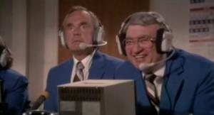 "Dick Enberg emotes as Mel Allen laughs during ""The Naked Gun."""