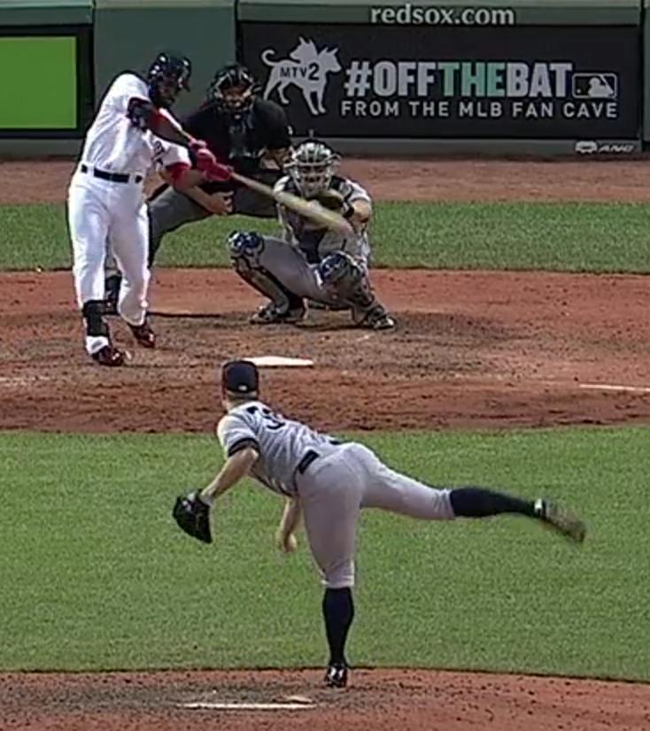 JBJ ball behind bat